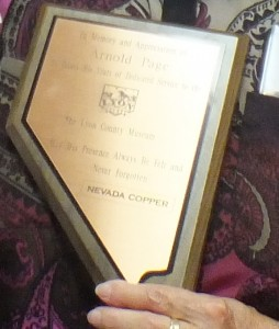 Mary Page, Lyon County Museum Director holds the award from Nevada Copper in memory of her husband, Arnold Page.  Tim Dyhr pictured with Mary Page