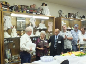 Tim Dyhr, Nevada Copper's VP of Environmental & External Relations hands over an award to Lyon County Museum Board Director Mary Page in honor and memory of husband, Arnold Page.