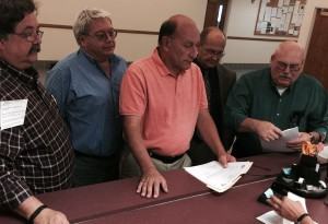 City of Yerington , Mayor George Dini signs the